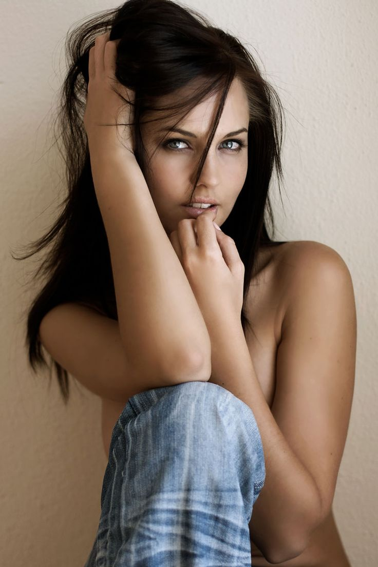 A beautiful girl with long flowing brown hair luscious lips and big blue eyes 9413